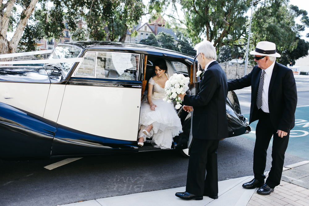 bride gets out of car