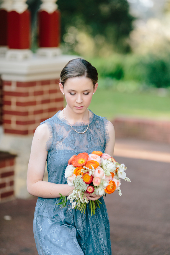 bridesmaid with zinnia floral designs bouquet