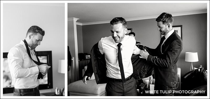 groom putting on suit