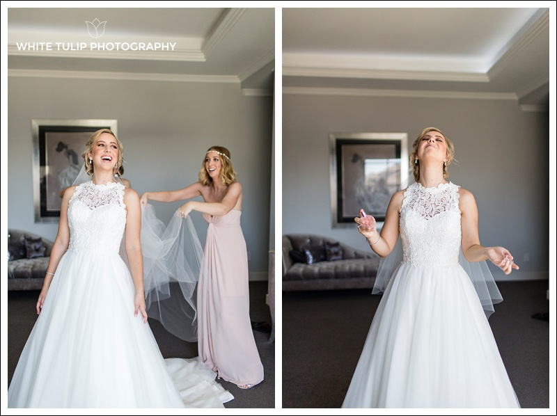 bridesmaid putting veil on bride