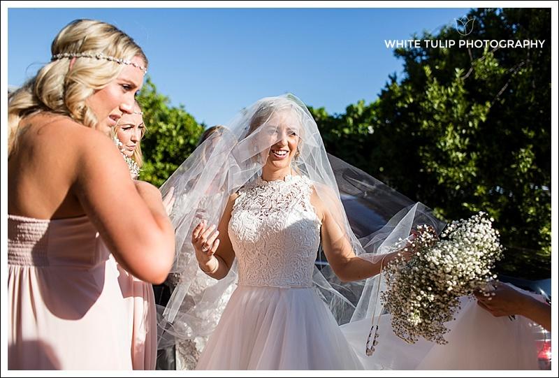 bride arrives at riverbank estate ceremony wedding
