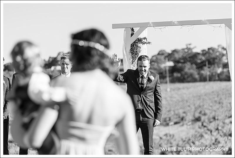 riverbank estate wedding ceremony groom waits