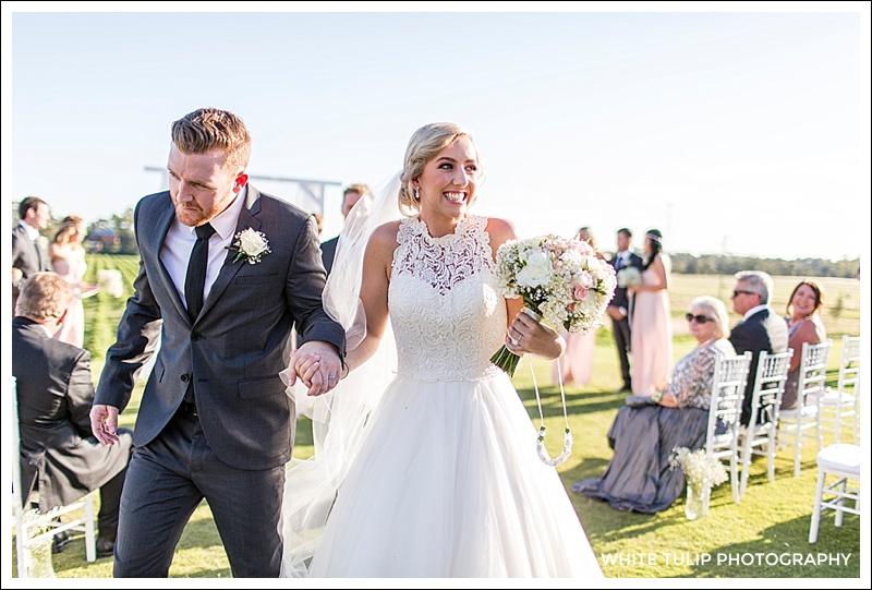 riverbank estate wedding ceremony bride and groom
