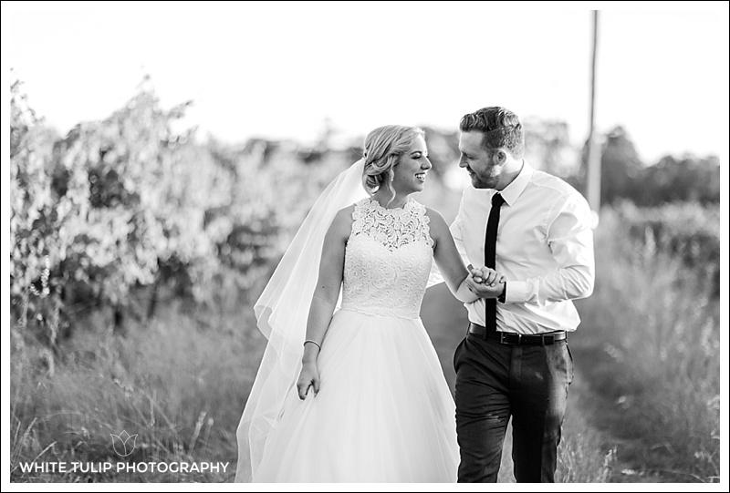 bride and groom in vineyard swan valley