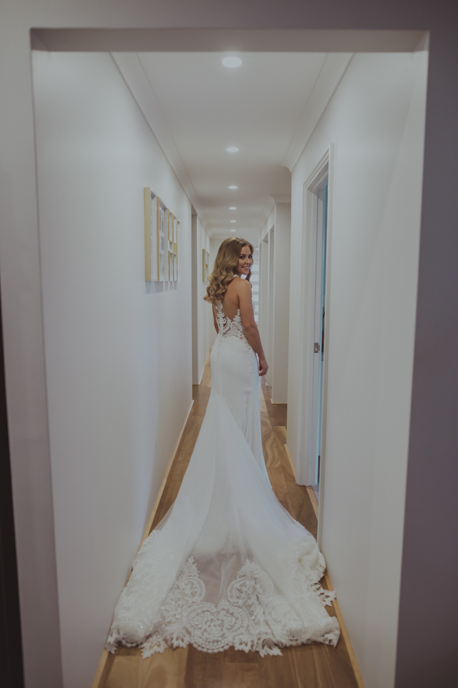 bride walks down hallway