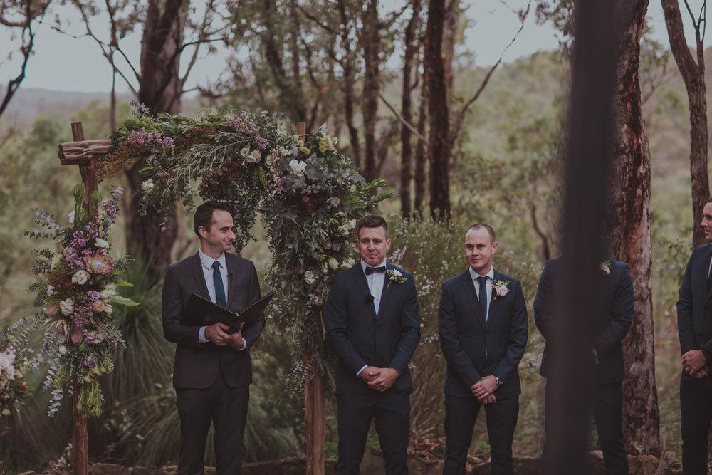 groom cries at wedding seeing the bride