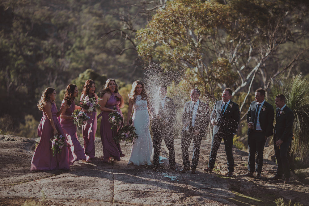 bridal party pops champagne