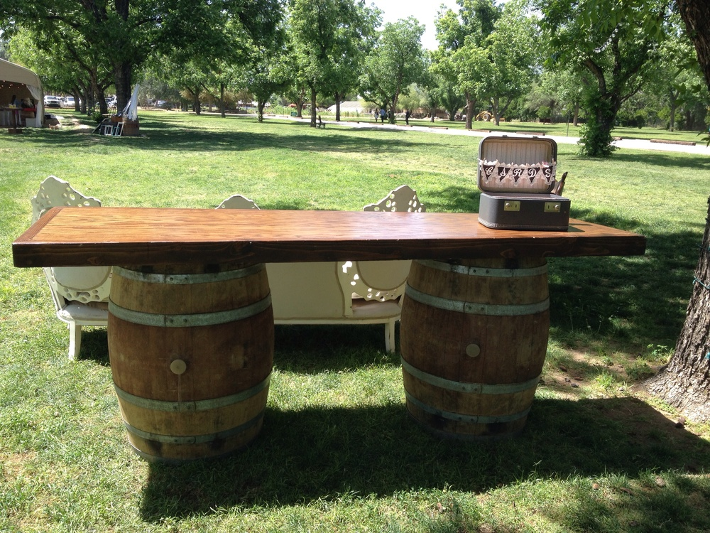 Wine barrel table and Prim card suitcase