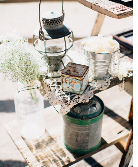 And again here with the rustic gasoline cans and crochet doilies.