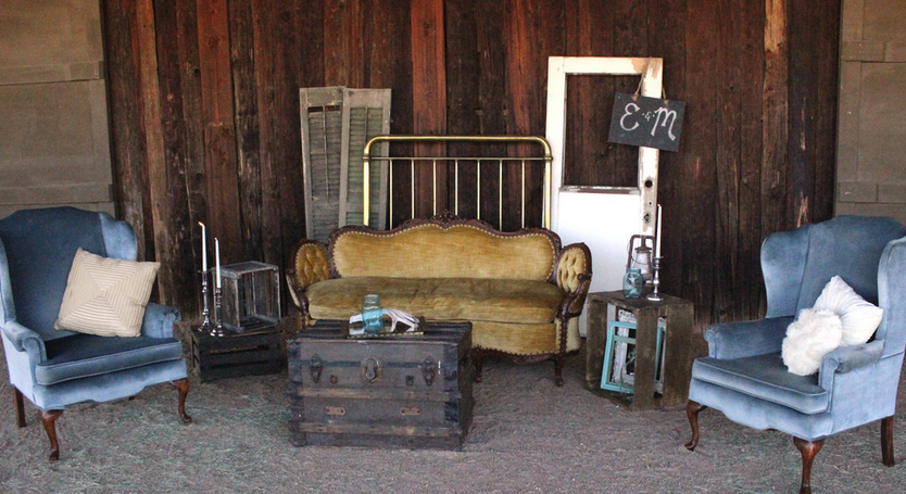 We created this lounge area up against the barn which was the perfect combination of rustic and vintage chic! Guests were able to enjoy themselves while lounging on our beautiful gold couch and blue vintage wingback chairs. The area was topped off with a brass headboard, old shutters, and a distressed kitchen door.  This is wedding was such a joyous occasion. It was lovely working with Laurie Cohenand her team from Sip and Twirl as well as Jason from Session Nine Photography.