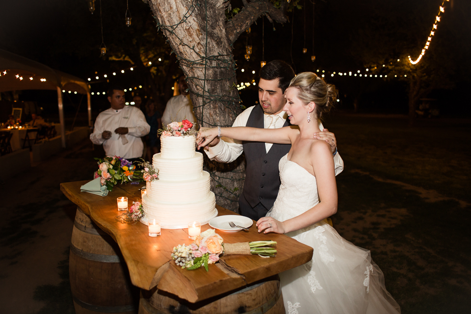 Bride and groom with wood top and wine barrel table