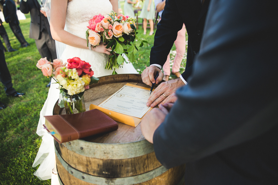 The bride and groom used Prim wine barrels for signing their marriage license