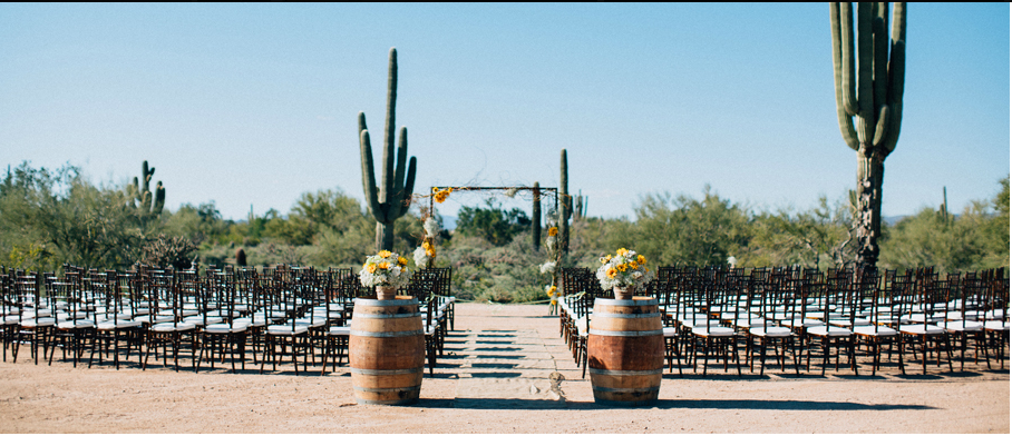 The Aisle Entrance we used here at Desert Foothills was more simplified but worked perfectly against the gorgeous desert landscape. Two wine barrels with beautiful floral arrangements was just what this picture perfect Ceremony needed!