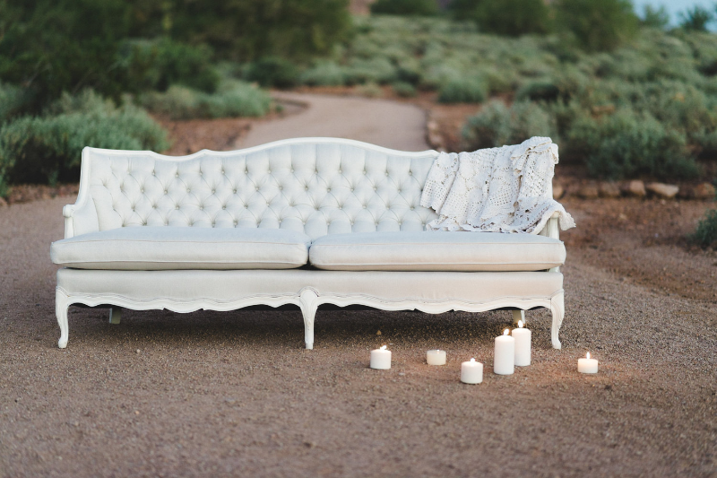 Introducing Audrey! She has beautiful tufted details and white wood accent. The fabric is a soft white with grey undertones. This couch is a great neutral color to go with any wedding!