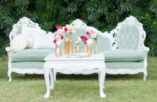 Introducing the Grace vintage sofa! Grace has a soft green color with white wood and tufting details.  This would fit well in many different types of events! Pictured above is our Glam Lounge setting package along with your choice of chairs.