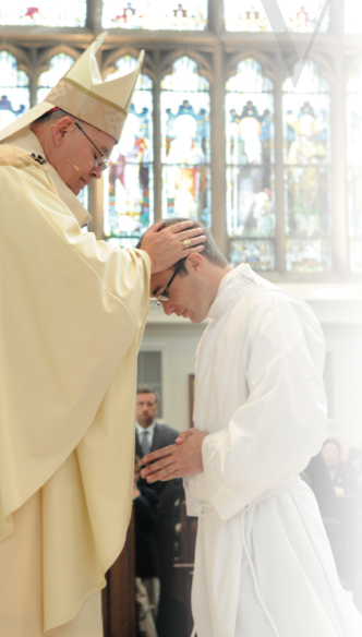 Archbishop Chaput and CU graduate Fr. Brian Larkin -Ordination 2011