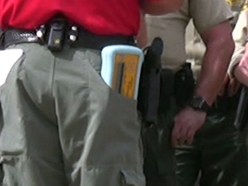 Control unit in officer's pocket-- resized.jpg