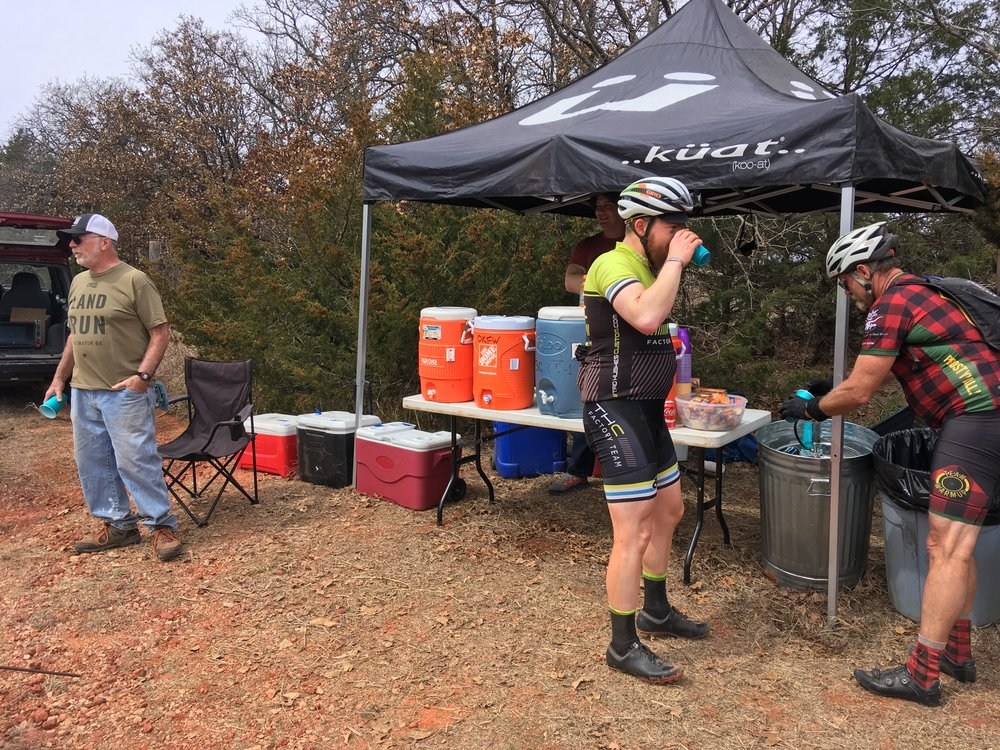 St. Patrick's day oasis at mile 75. Skratch Labs, water, beer, Irish Whiskey.  Thanks, fellas. That was the best bad decision I made all day.