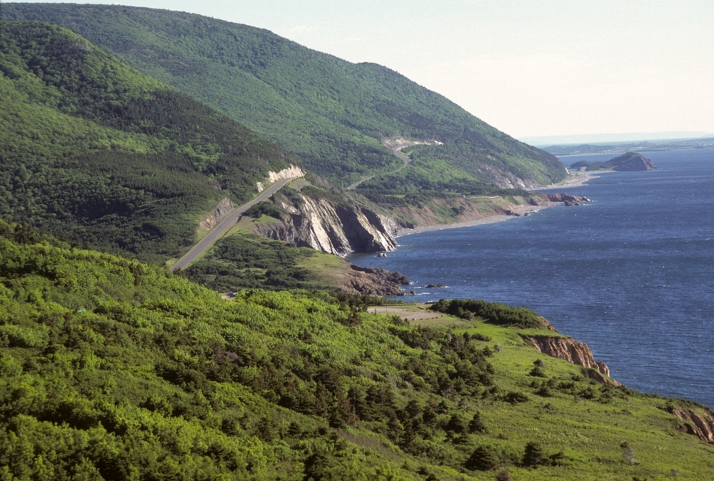Cabot Trail cycling - steepest hill (80km hr downhill) road into distance around coast (1024x690).jpg