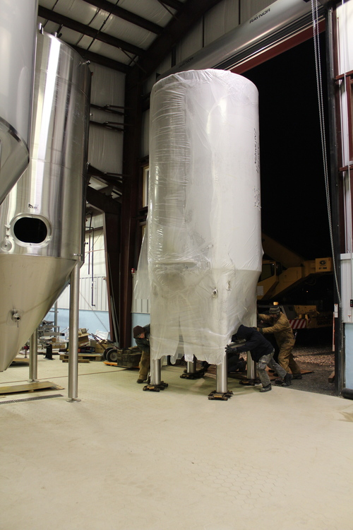 One of the shorter tanks being placed