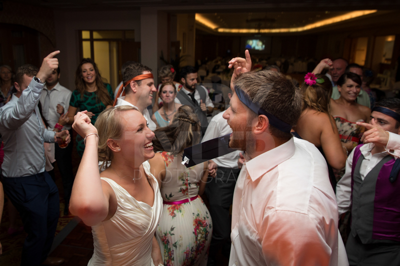 Bride & Groom going for it.jpg