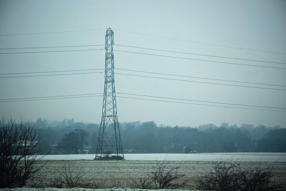Pylon in a field in winter