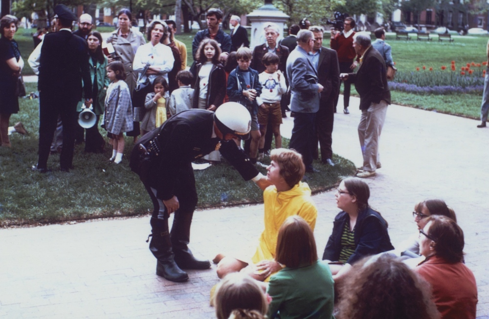 Mrs. Eleanor McPhillips confronted by a police officer during a sit-in against the Vietnam war in Lafayette Park, May, 1970.