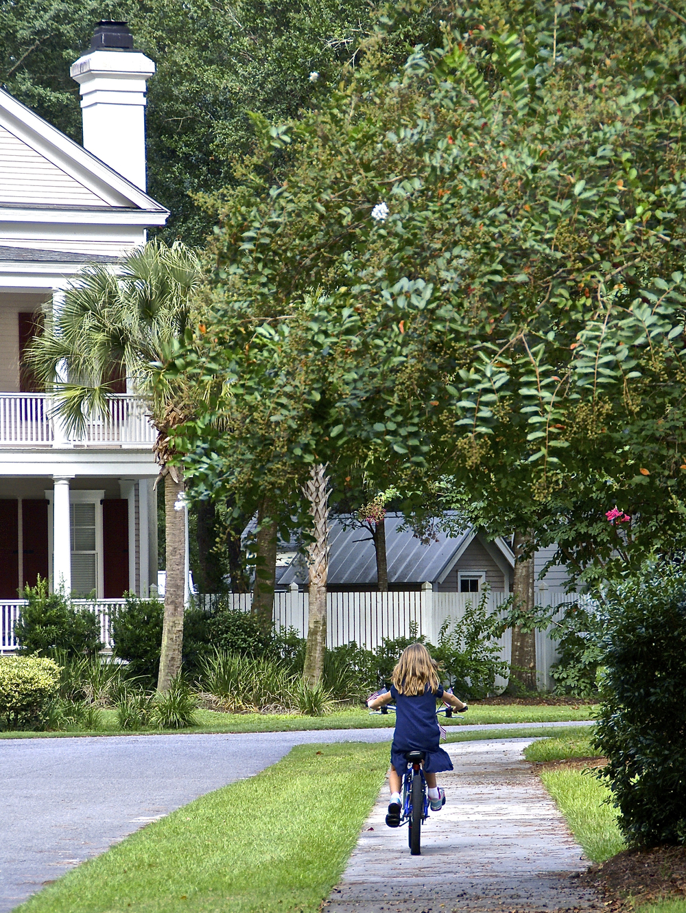 Houses facing streets safe for children to bike along in Habersham, here in Beaufort County SC