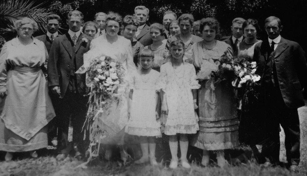 Mr. James Logan (far right) and the Logan family at one of his son's wedding. (Click image to enlarge)