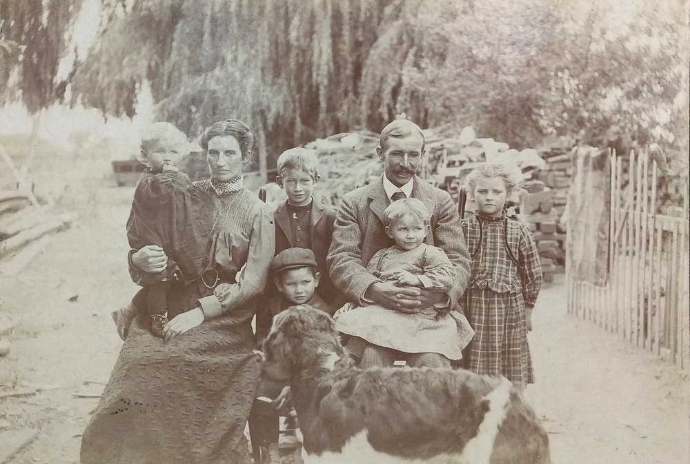 Mr. Logan, alongside Mrs. Logan and five out of their twelve children.  (Click image to enlarge)