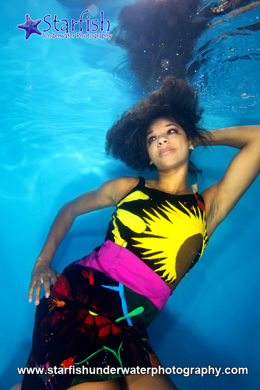 Krystal Geddes models a hand painted dress by creativeplanets underwater.
