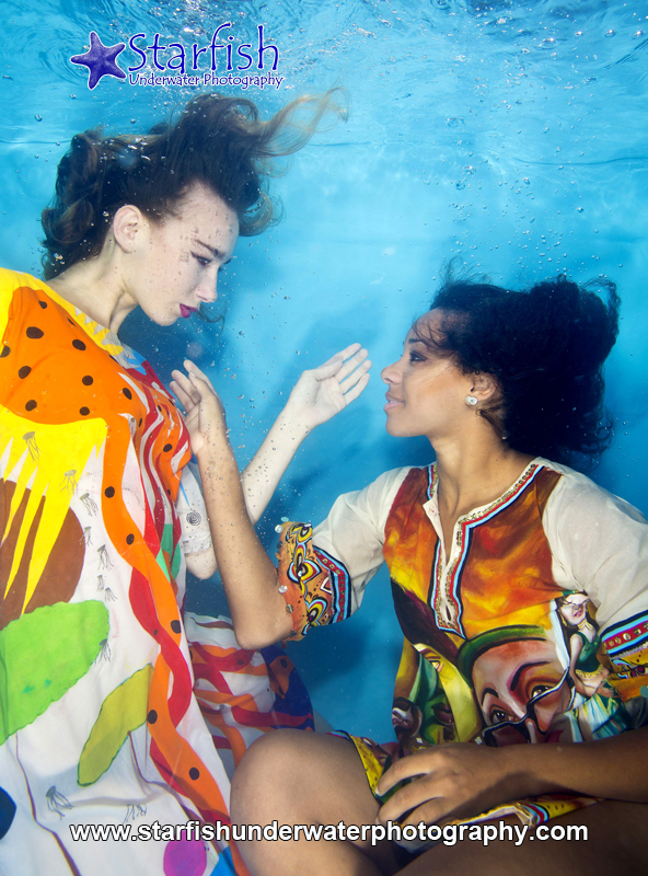 Emily Rose Arno and Krystal Geddes models a hand painted dress by creativeplanets underwater.