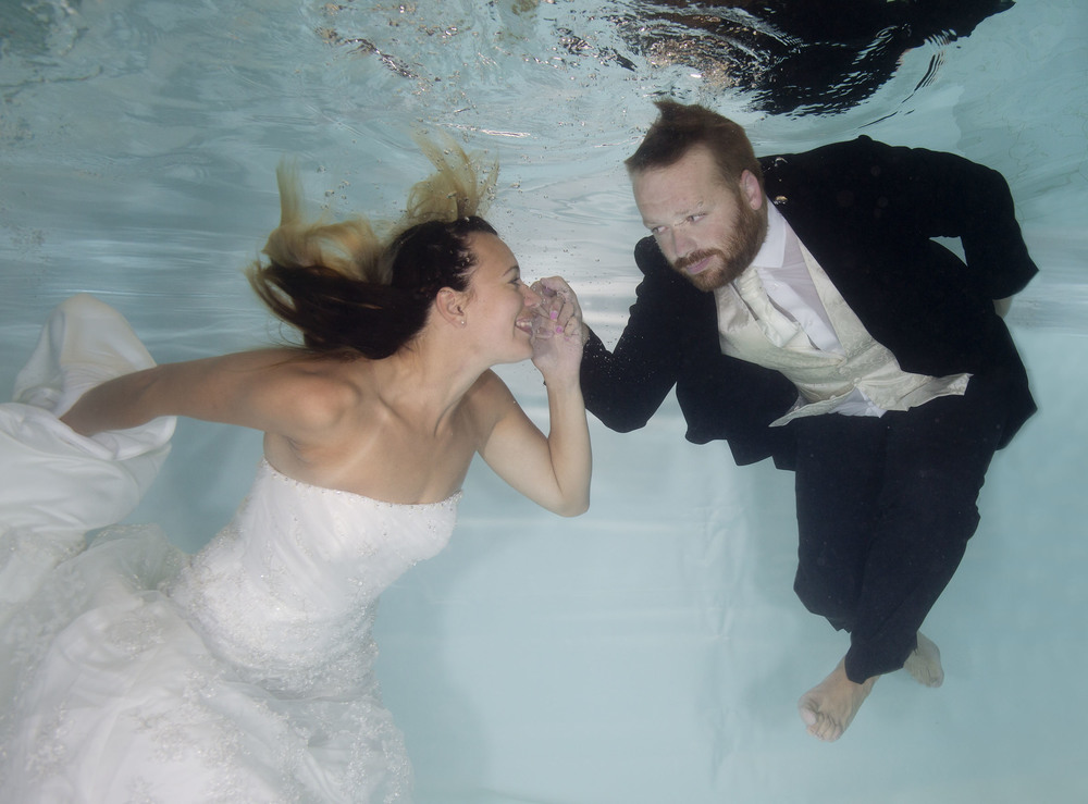 Becky and Keith jumped in the pool in their wedding clothes!