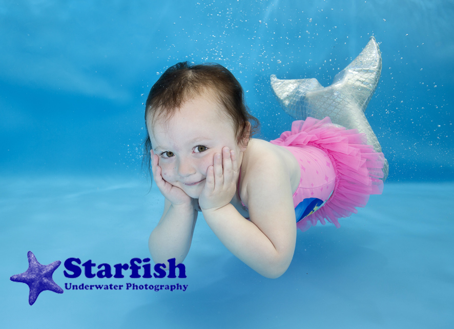Macy Shannon, 2, makes a mermaid pose at an underwater photo shoot in Shrewsbury with Swim with Style Swim School.