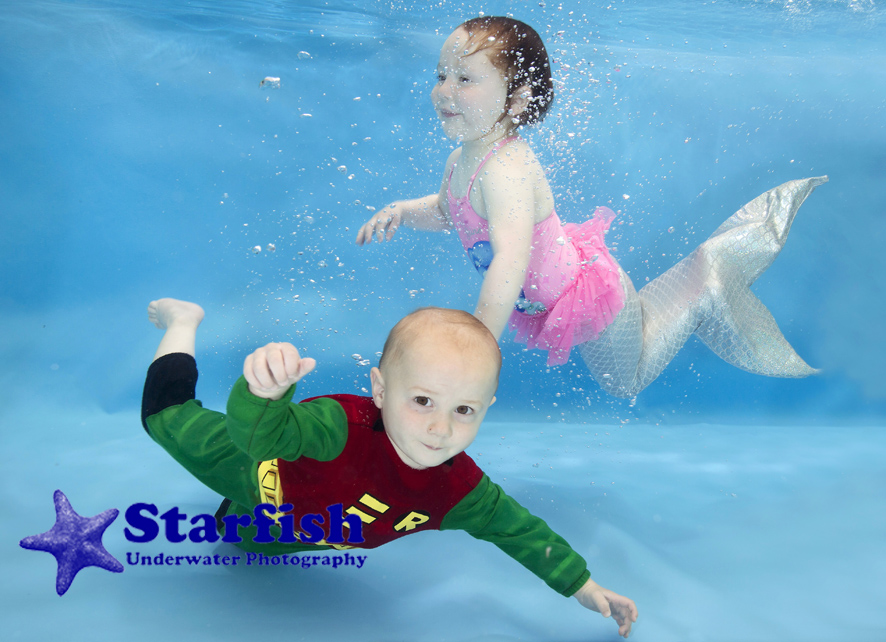 Cian Shannon, 1, and Macy Shannon, 2, play dress-up underwater style, at a photo shoot in Shrewsbury with Swim with Style Swim School.