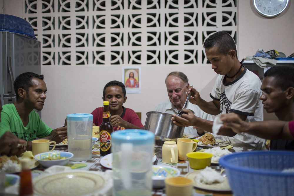 Brother John sharing a meal with young men in the Postulancy Comnmunity in Baucau, Timor Leste.