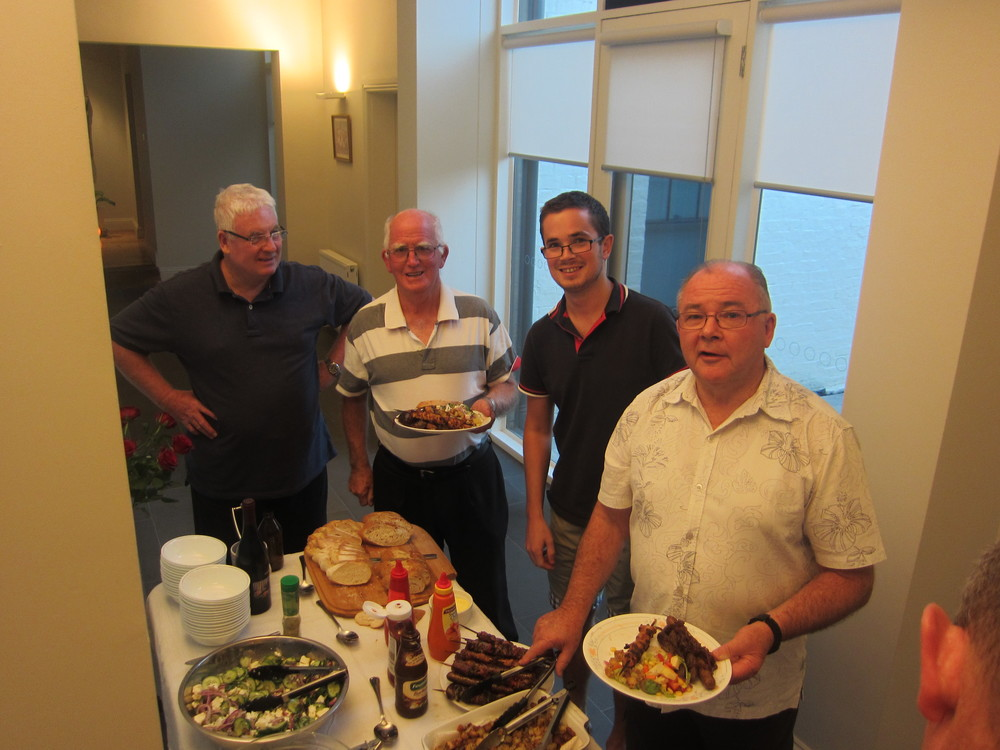 Brothers Hubert, Doug, Patrick and Des enjoying a community meal.