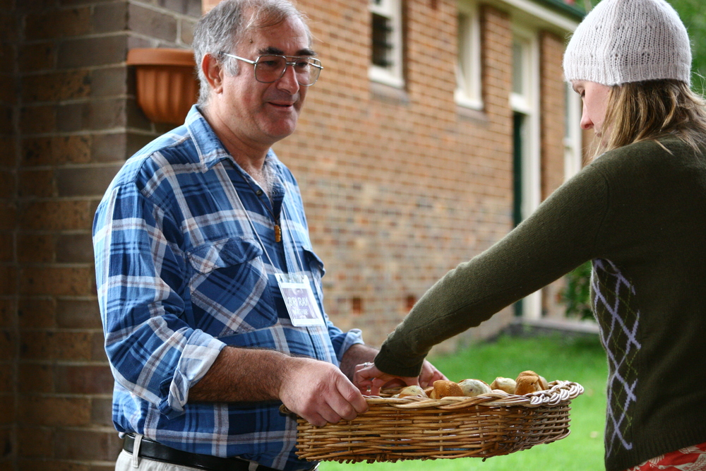 Hospitality and a spirit of welcome are core to our lives as Brothers. Br Ray offering fresh apples at the Hermitage, Mittagong.