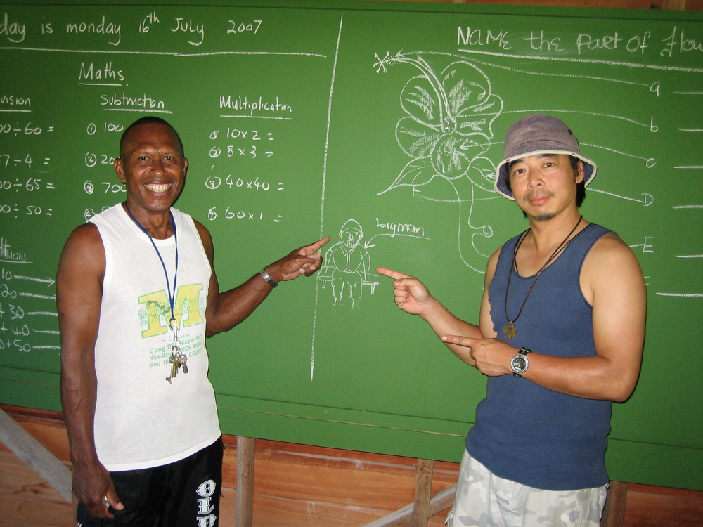Chalkboard experts! Br Henry from the Solomon Islands with Br Tony Leon at Vanga Point.