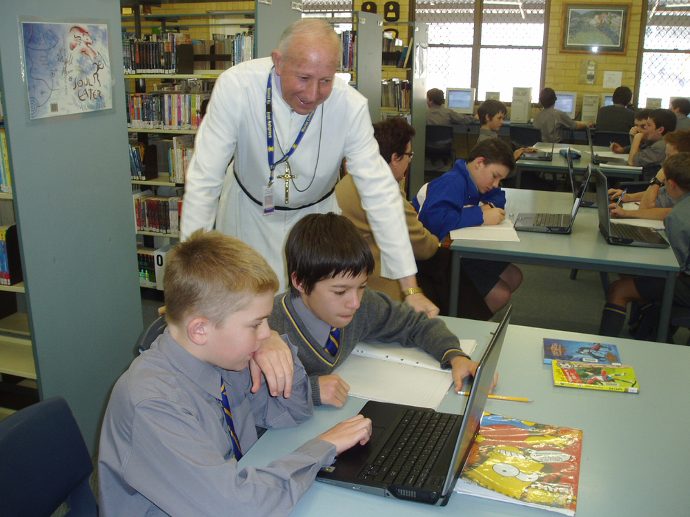 Br Adrian assisting students at Marist College Ashgrove.