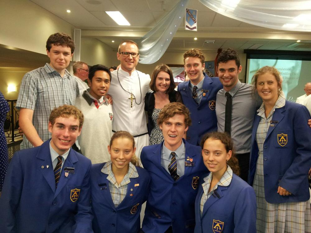 Br Justin with students from Trinity Catholic College Lismore.