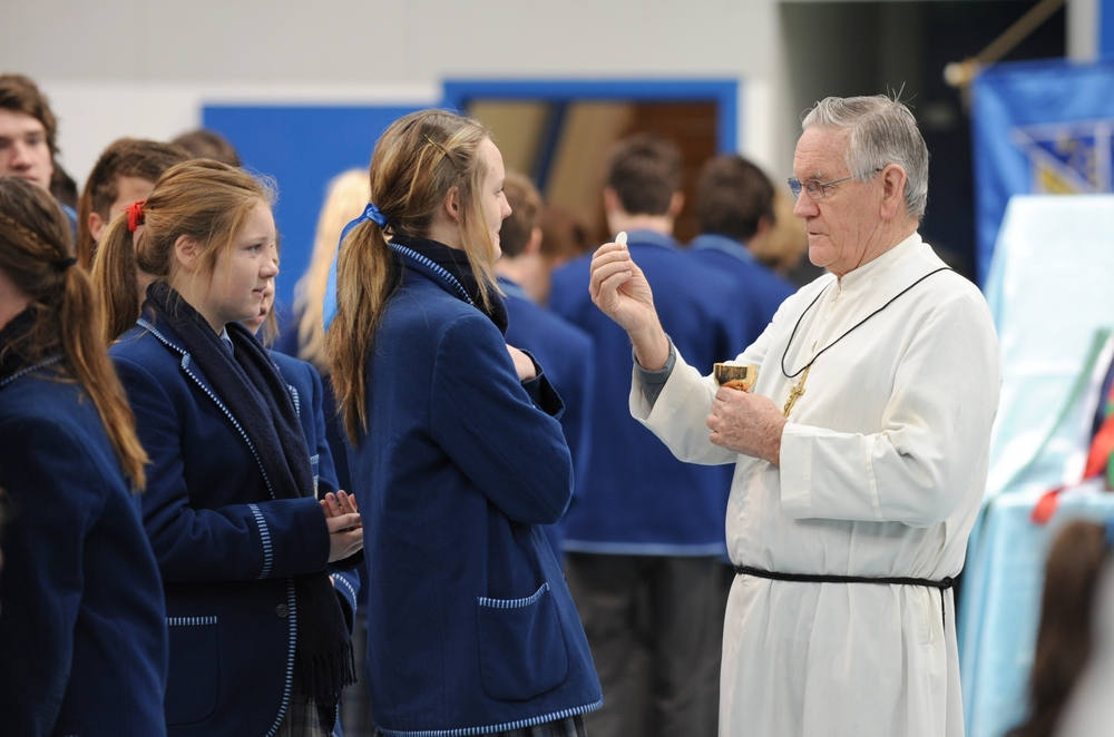 Br Greg distributing Holy Communion to students at Sacred Heart College, Somerton Park, Adelaide.