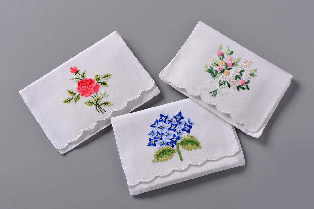 "Left: #4006R-PE Hand Embroidered Rose Envelope – Suggested Retail Price $15  Right: #4009-PE Hand Embroidered Eyelet Bouquet Envelope - Suggested Retail Price $15  Center: #4110-PE Hand Embroidered Hydrangea Envelope – Suggested Retail Price $15  #LV-001 Paper ""Tea-Bag"" Sachets Filled with Lavender - Suggested Retail Price $6"