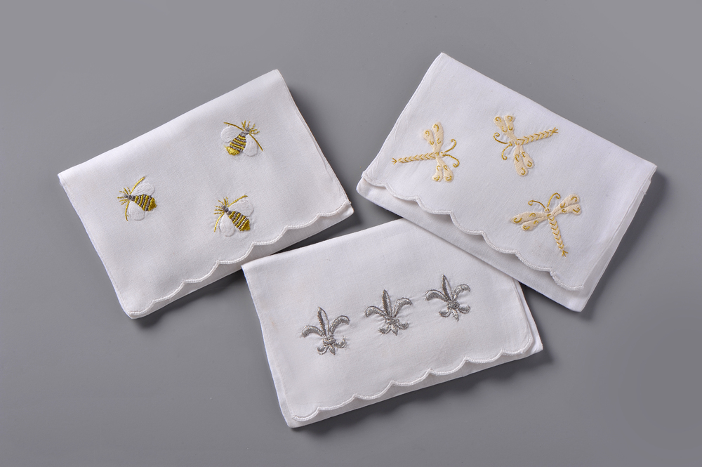 "Left: #4225-PE Hand Embroidered Bumble Bees Envelope – Suggested Retail Price $15  Right #4224-PE Hand Embroidered Dragonflies Envelope – Suggested Retail Price $15  Center: #4221-PE Hand Embroidered Fleur de Lis Envelope – Suggested Retail Price $15  #LV-001 Paper ""Tea-Bag"" Sachets Filled with Lavender - Suggested Retail Price $6"