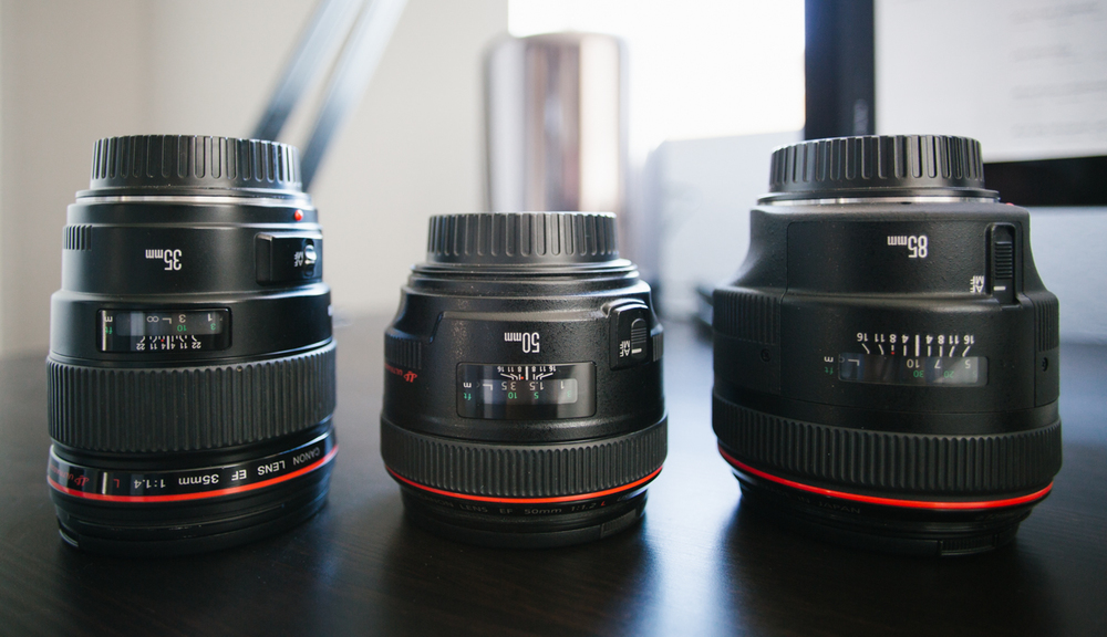 My 35mm, 50mm, and 85mm. Shot on a 20mm at f2.8 to show the distortion + bokeh effect.
