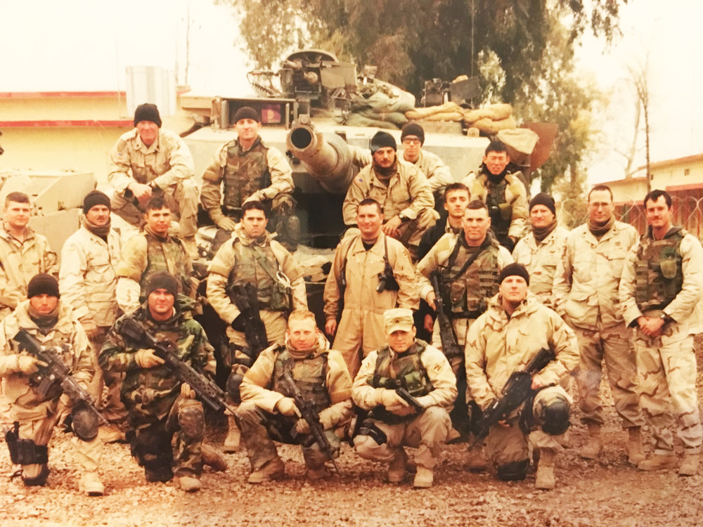 OIF 1 (In the very back right with a black beanie and glasses) MOSUL, Iraq 2005. Very fun to bomb around in tanks as a medic.