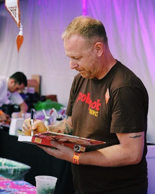 Chef Andy Ricker of Pok Pok, Pok Pok Noi, Sen Yai, and Whiskey Soda Lounge signs his latest cookbook at Feast Portland's Night Market.