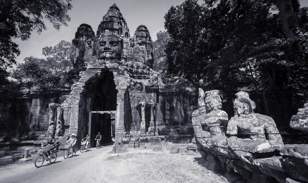 This stone gate house is one of the entrances to Angkor Thom, The Great City, the capitol city of the Khmer Empire, and was built over 800 years ago. Angkor Cambodia.