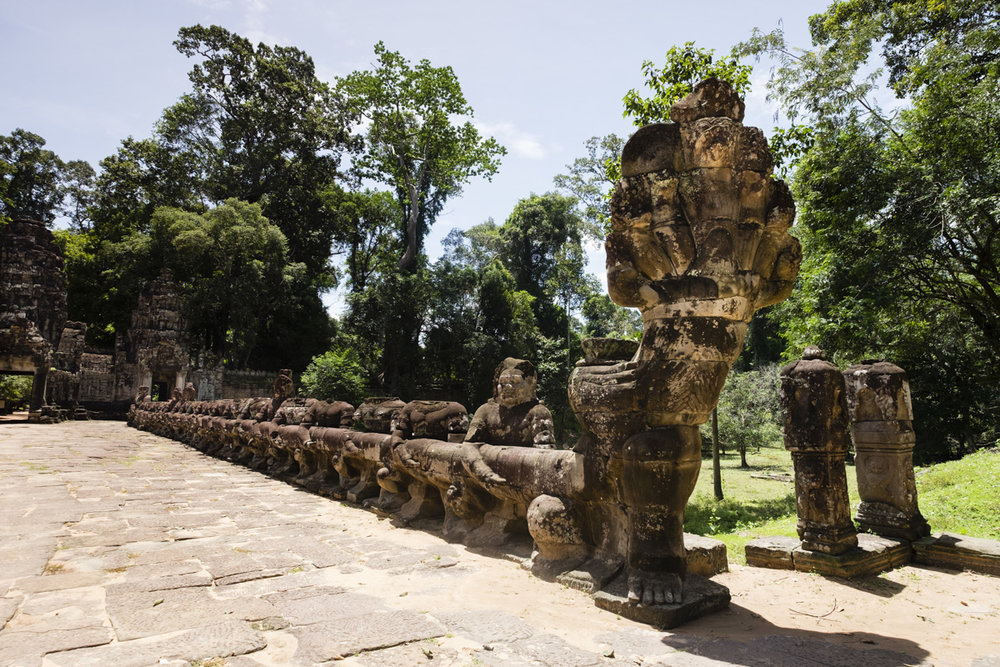 "The entry bridge at Preah Khan (meaning ""Royal Sword"") is a temple at Angkor, Cambodia, built in the 12th century for King Jayavarman VII to honour his father."