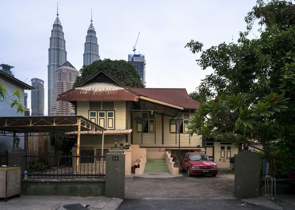 As the city encroachs the traditional village of Kampung Baru, Kuala Lumpur.